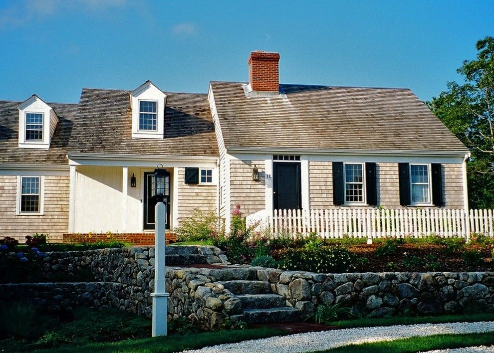 Cape Cod Lumber   Traditional Exterior Also Brick Chimney Cape Cod Style Cottage Dormer Windows Entrance Entry Front Door Grass Lamppost Lawn Outdoor Stairs Picket Fence Ribbon Driveway Shake Roof Shingle Siding Stone Wall Turf Wood Fencing