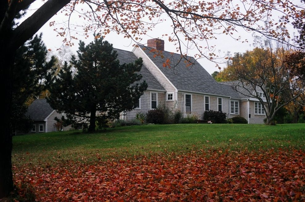 Cape Cod Lumber with Traditional Exterior Also Autumn Cape Cod Style Fall Field Grass Hillside Lawn Seasonal Shingle Siding Slope Turf White Trim