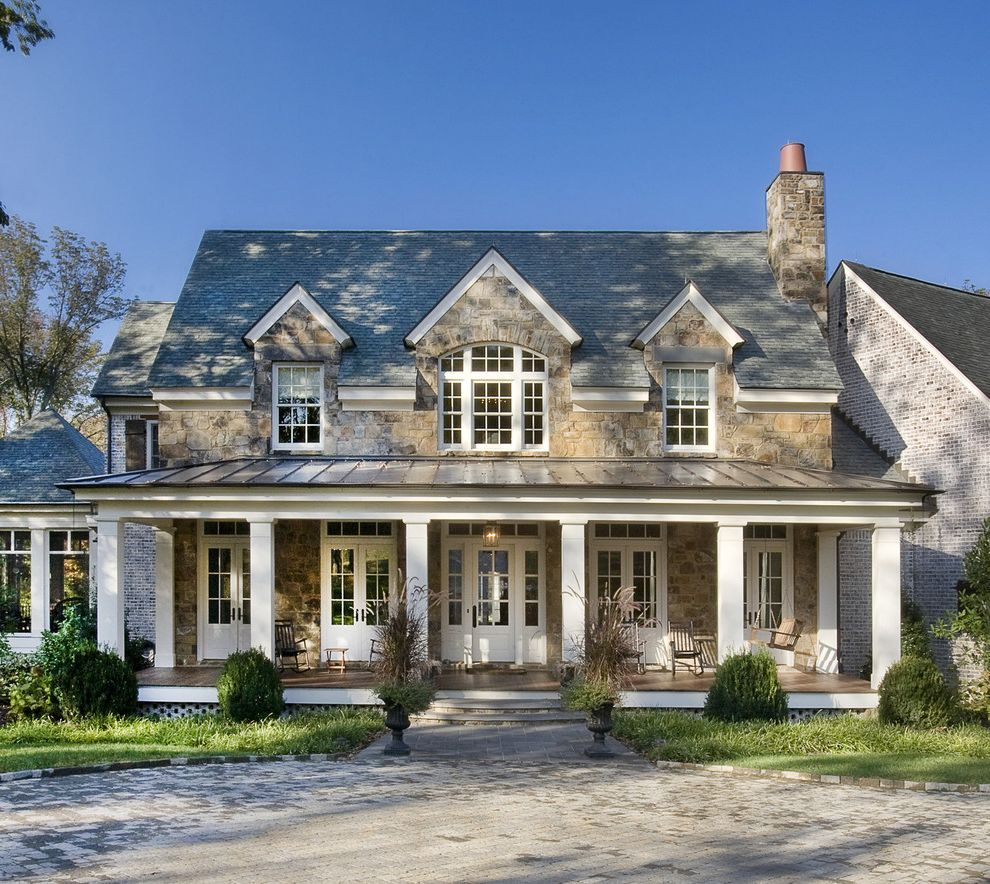 Capital One Home Loans   Traditional Exterior Also Columns Covered Patio French Doors Outdoor Seating Porch Rocking Chair Shingles Stacked Stone Standing Seam Roof Swing Transom Windows White White Window Trim