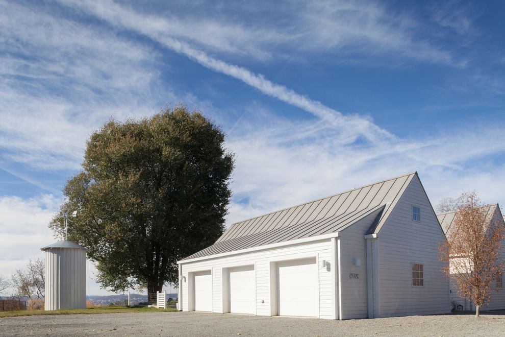 Car Donations Denver with Farmhouse Garage Also Gable Roof Gravel Driveway Metal Roof No Eaves Shed Roof Shingle Siding Silo Three Garages White Exterior