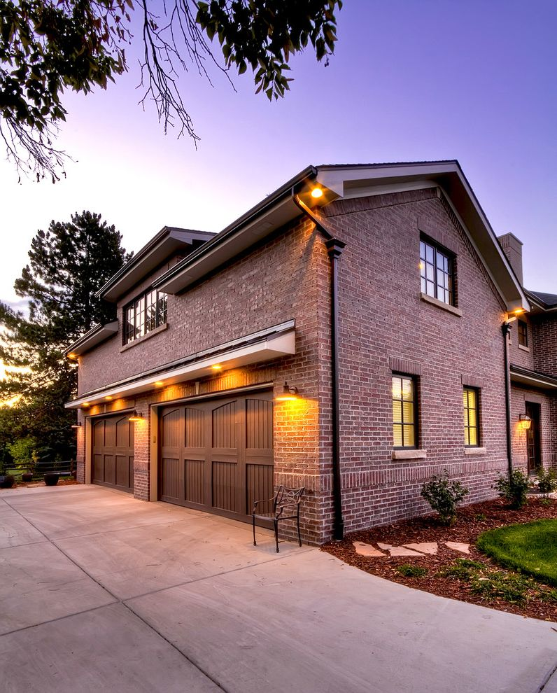 Car Donations Denver with Traditional Garage Also Brick Siding Brown Garage Doors Driveway Gable Roof Outdoor Lighting