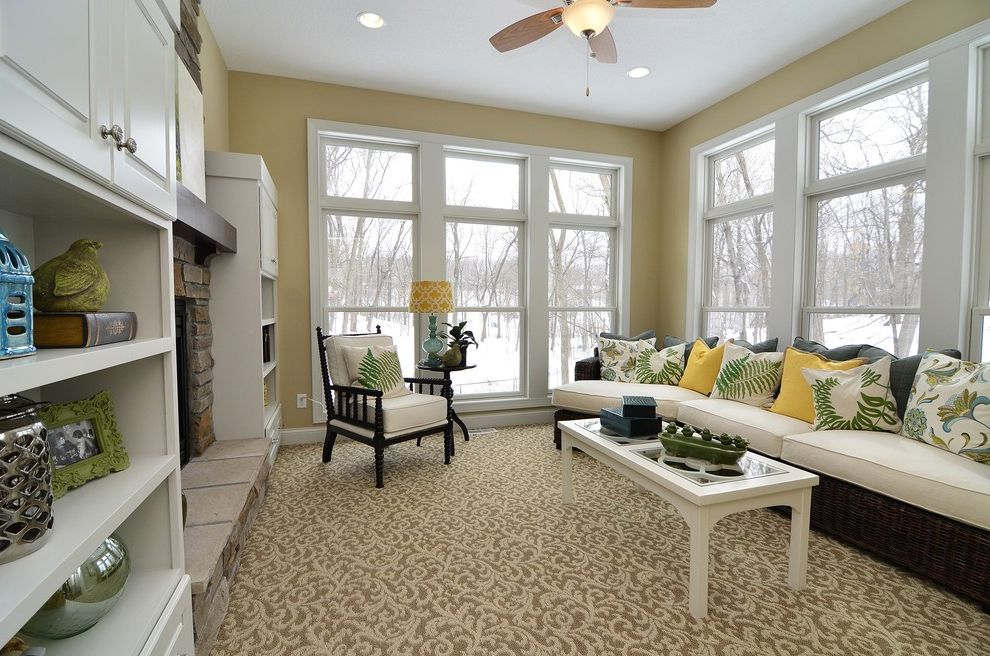 Carpet Cleaning Stillwater Ok   Traditional Family Room  and Area Rug Built in Cabinets Ceiling Fan Coffee Table Hearth Mantel Open Shelving Pillows Seat Cushions Sectional Stone Fireplace White Painted Trim Yellow