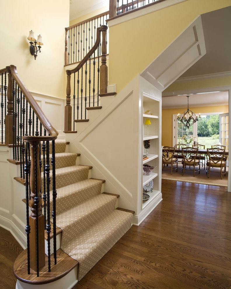 Carpet Cleaning Stillwater Ok   Traditional Staircase  and Built in Shelves Built in Storage Dining Room Entry Oak Handrail and Newel Posts Paneled Details Runner Under Stairs Storage Wainscotting Walls Wood Flooring Wrought Iron Railings Yellows