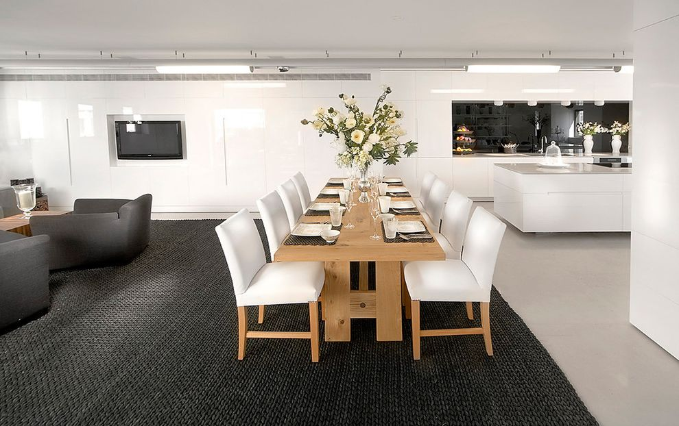 Carpet Cleaning Sunnyvale Ca with Contemporary Dining Room  and Area Rug Black and White Ceiling Lighting Centerpiece Floral Arrangement Glossy Wall Great Room Minimal Open Floor Plan Table Setting Tablescape Trestle Table Wood Dining Table