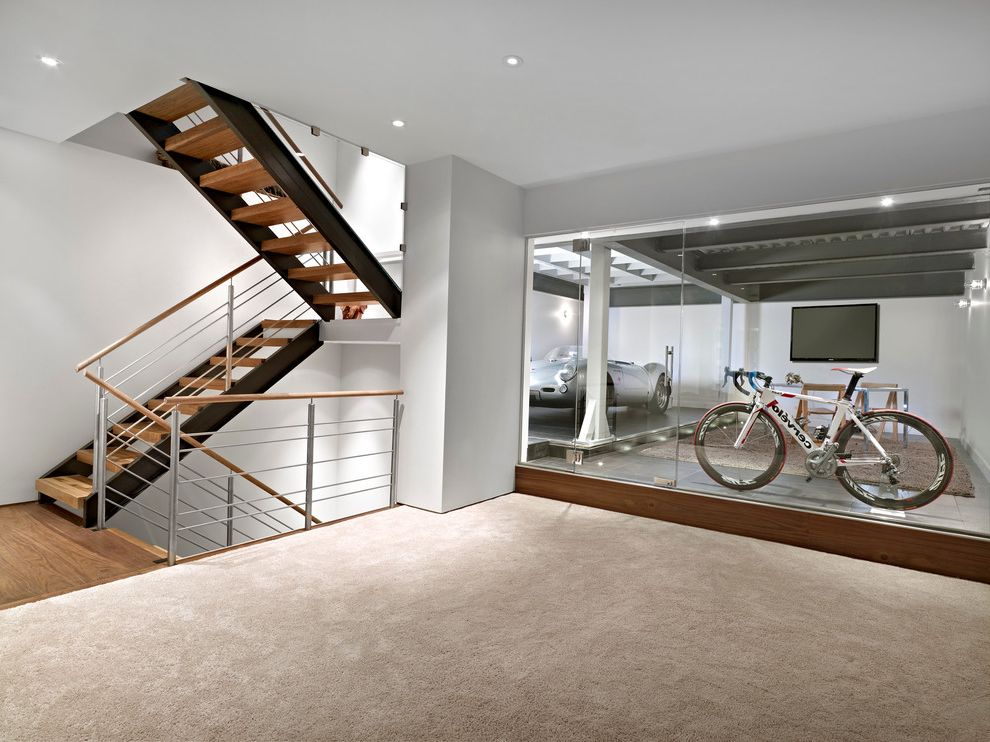 Carpet Garage Missoula with Contemporary Basement  and Bike Storage Carpeting Garage Glass Walls Metal Railing Minimalist Open Tread Stairwell Steel Girders White Walls Wood Floor Wood Slab