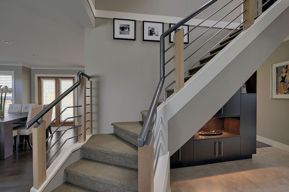 Carpet One Columbia Sc   Contemporary Staircase Also Black and White Photographs Built in Cabinet Carpeted Stairs Gray Carpet Gray Walls Hardwood Floors Metal Handrail Metal Railing Modern Railing Tile Floor