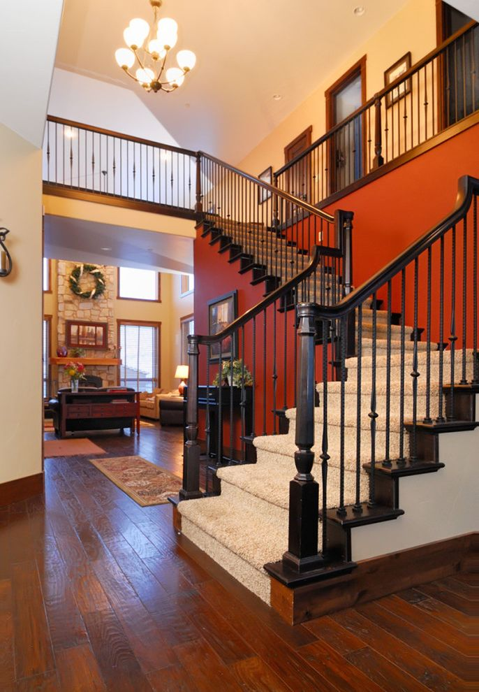 Carpet One Columbia Sc   Traditional Entry Also Accent Wall Carpet Chandelier Fireplace Orange Rock Rug Side Table Stairs Stone Vaulted Ceiling Wood Floor