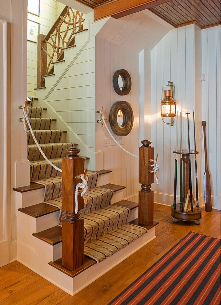Carpet One Columbia Sc with Traditional Staircase Also Beadboard Ceiling Branch Railing Brass Lantern Nautical Theme Paddle Pool Cues Rope Handrail Round Mirror Staircase Staircase Runner White Walls Wood Beams Wood Floor Wood Paneling Wood Stairs