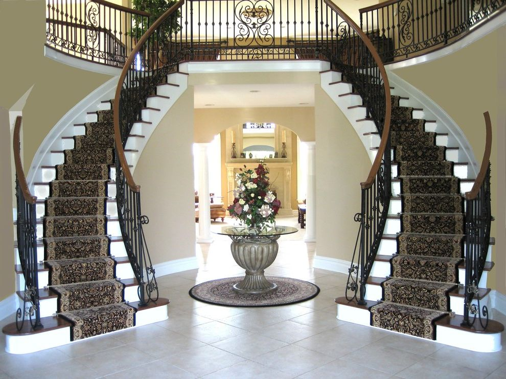 Carpet One Columbia Sc with Traditional Staircase  and Banister Carpet Runner Console Table Double Staircase Entrance Entry Entry Table Floral Arrangement Foyer Oriental Rug Round Rug Stair Rods Staircase Rug Tile Flooring White Wood Wood Trim