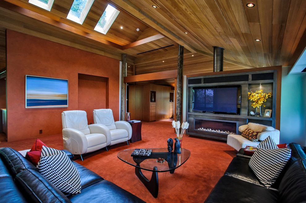 Carpets by Dennis   Modern Family Room  and Black Leather Sofa Ceiling Lighting Faux Finish Glass Coffee Table Leather Recliners Midcentury Modern Recessed Lighting Red Carpet Red Walls Skylights Sloped Ceiling Vaulted Ceiling Wood Ceiling