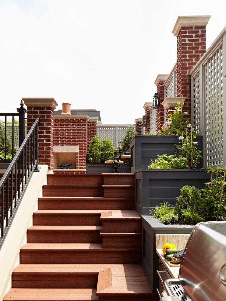 Case Study Planters with Traditional Deck  and Brick Pillars Built in Grill Built in Planters City Home Metal Railing Outdoor Fireplaces Townhome Townhouse Wood Decking