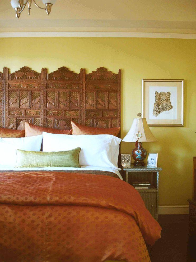 Cast Iron Headboard   Indian Bedroom Also Bedside Table Carved Wood Nightstand Orange Duvet Silk Pillows Table Lamp Wall Art Wall Decor Wicker Furniture Wood Headboard Wood Screen Yellow Wall