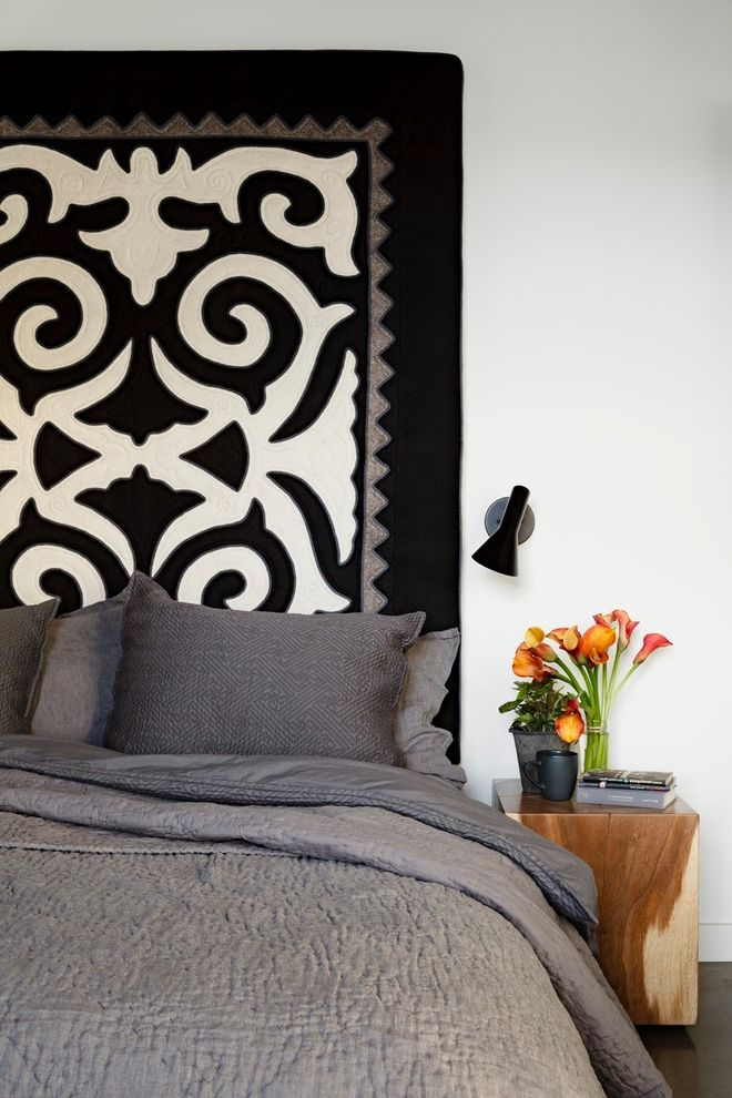 Cast Iron Headboard   Industrial Bedroom  and Bedding Black and White Decorative Pattern Felt Flowers Gray Bedding Nightstand Pillows Potted Plant Sconce Upholstered Headboard Vase White Wall
