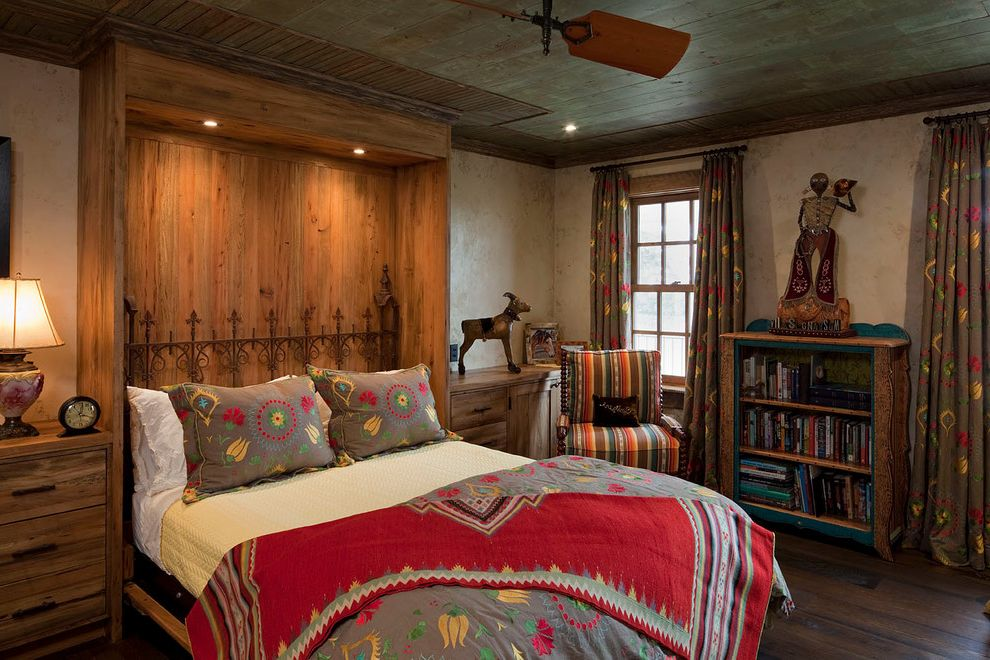 Cast Iron Headboard   Rustic Bedroom  and Antiques Armchair Bedside Tables Built Ins Ceiling Fan Flex Room Murphy Bed Recliamed Wood Red Table Lamp Turquoise Ceiling Wood Ceiling Wood Floors Yellow