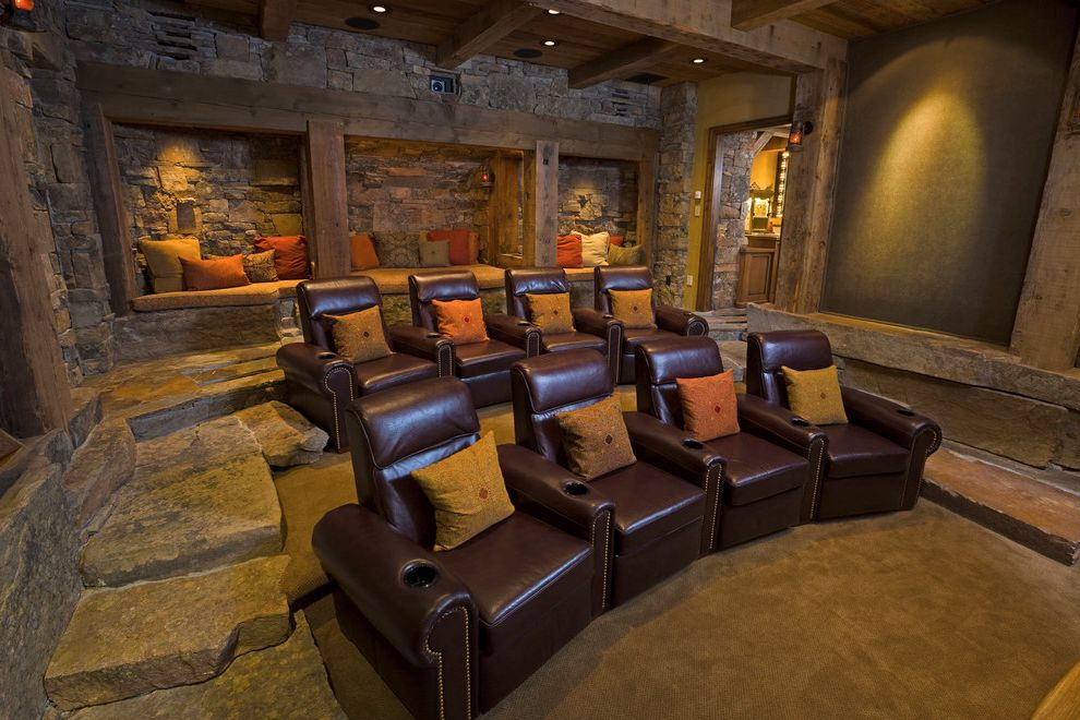 Castle Rock Theater   Rustic Home Theater Also Built in Seating Fireplace Home Theater Lanterns Leather Recliners Lodge Media Room Projector Stadium Seating Stone Stone Accents Stone Floors Theater Timber Accents