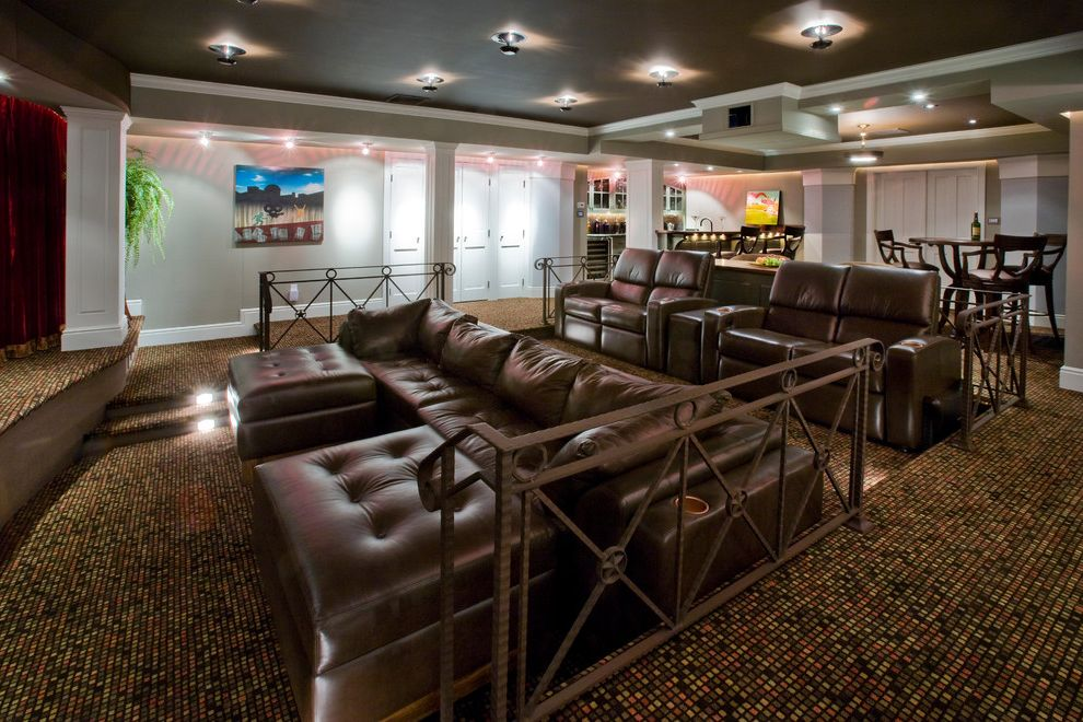 Castle Rock Theater   Traditional Home Theater Also Basement Beige Ceiling Beige Wall Ceiling Lighting Home Theater Leather Armchair Leather Ottoman Leather Sectional Media Room Metal Railing Movie Room Patterned Carpet White Molding White Trim