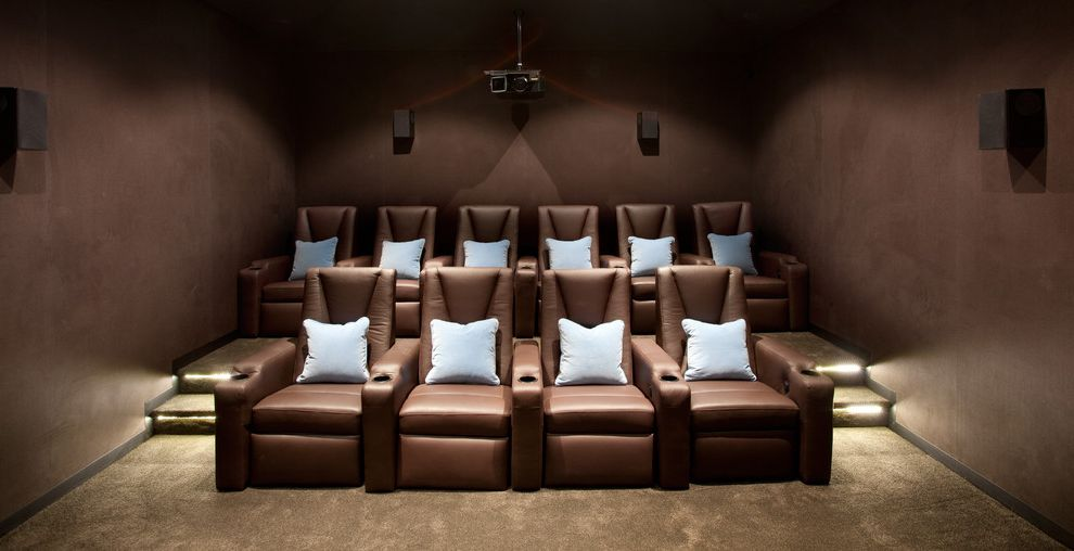 Cedar Falls Theater   Contemporary Home Theater Also Brown Armchair Brown Carpet Brown Walls Dark Room Home Theater Light Blue Pillows Movie Projector Stair Lighting Theater Seating Tiered Seating