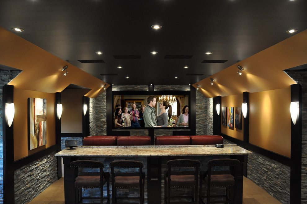 Cedar Falls Theater   Contemporary Home Theater  and Artwork Bar Seating Bar Stools Black Ceiling Gold Home Theater Red Leather Armchairs Rock Walls Stone Veneer Stone Wainscoting Wall Sconces