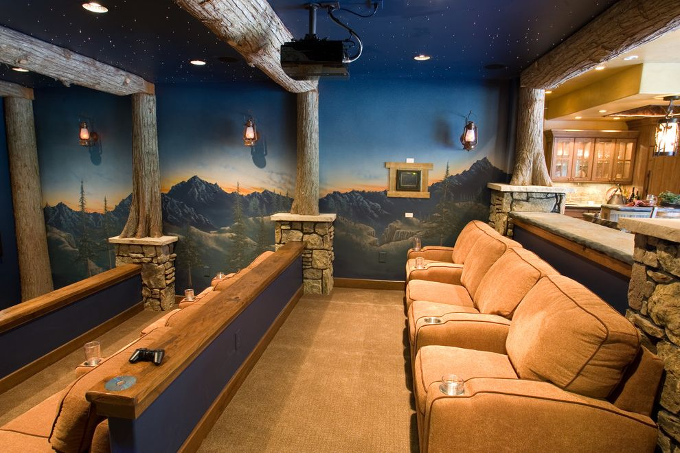 Cedar Falls Theater   Rustic Home Theater  and Carpeting Cineman Seating Crestron Controls Fiber Optics Logs Media Room Mountains Mural Painting Rustic Sconce Lighting Stonework Theater Tiered Western Red Cedar