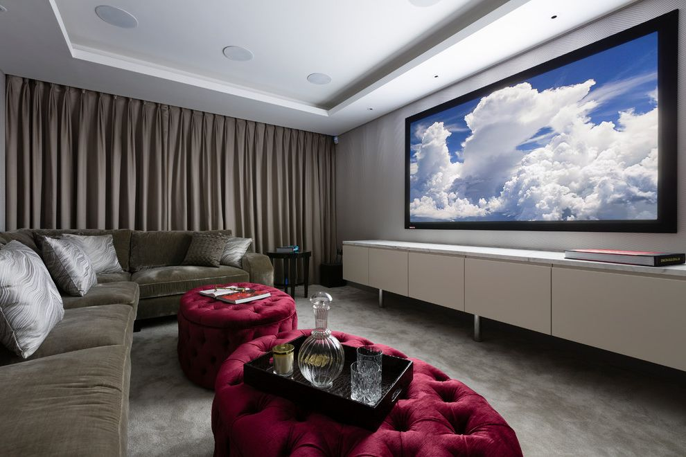 Cedar Falls Theater   Transitional Home Theater  and Cinema Contemporary Gray Curtain Gray Sectional Gray Throw Pillows Hampstead London Luxury Red Tufted Ottoman Tray Ceiling White Media Unit