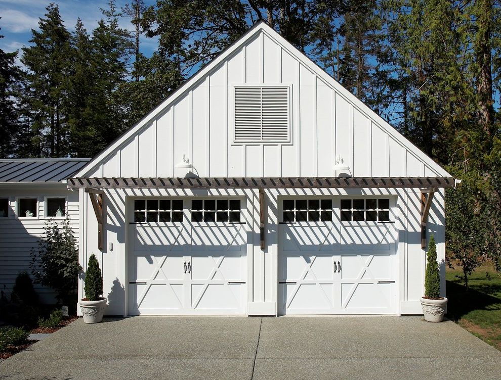 Cedar Park Garage Doors   Eclectic Garage Also Aggregate Bark Mulch Board and Batten Siding Carriage Doors Cast Stone Pots Concrete Driveway Gable Roof Lap Siding Metal Roof Pergola Topiary Two Car Garage Weathered Wood