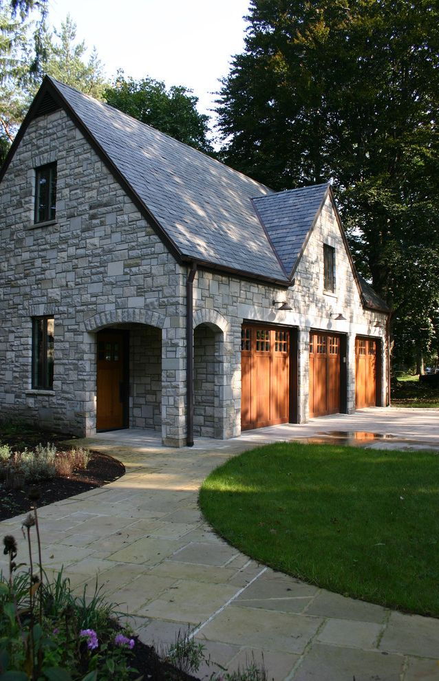 Cedar Park Garage Doors   Traditional Garage  and Arch Entryway Outdoor Lighting Single Garage Doors Stone Exterior Stone Pathway Stone Walkway Wood Front Door Wood Garage Door