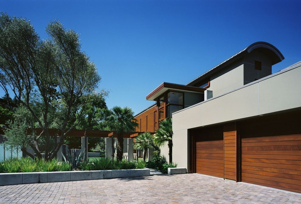 Cedar Park Garage Doors with Contemporary Exterior Also Brick Paving Concrete Columns Concrete Seat Wall Entrance Entry Garage Garage Doors Olive Trees Palm Trees Pergola Planters Trellis Wood Siding