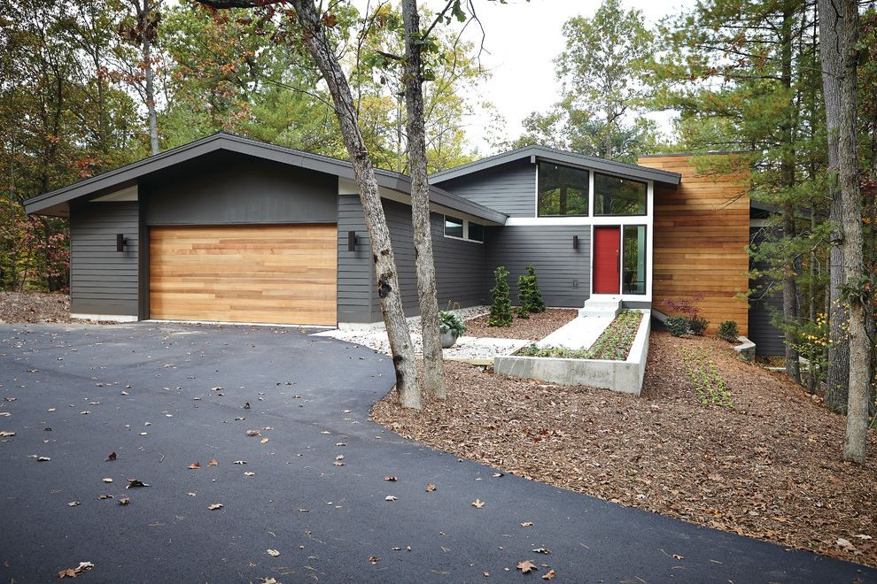 Cedar Park Garage Doors with Eclectic Exterior  and Asphalt Driveway Clerestory Windows Front Door Gray Fascia Gray Siding Mixed Siding Materials Red Door Red Front Door Two Car Garage Wall Lights Wall Sconces Wood Garage Door Wood Siding