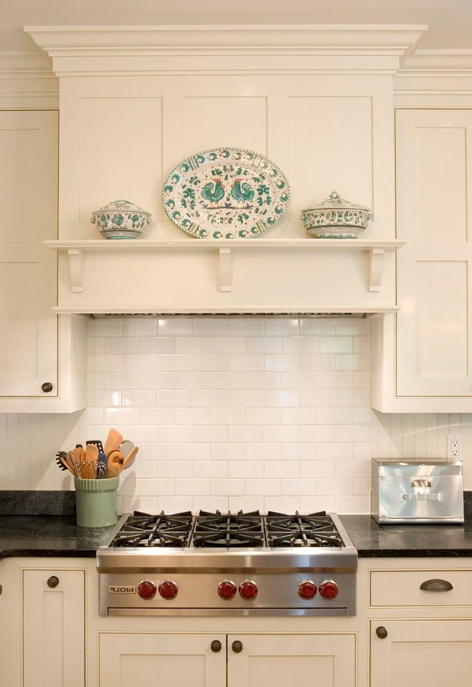 Ceiling Mount Vent Hood   Traditional Kitchen  and Black Counters Black Soapstone Countertops Cup Pulls Custom White Cabinetry Frame and Panel Woodwork Hood Shelf Tile Backsplash White Crown Moulding White Painted Wood Wolfe Stove Top