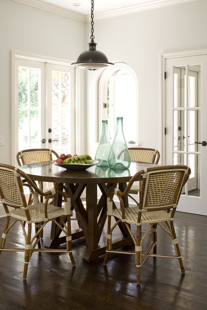 Chair Pads for Kitchen Chairs   Traditional Dining Room  and Arch Doorway Beach Bistro Chairs Breakfast Centerpiece Chairs Dark Floor Demijohns Pendant Lighting Round Dining Table Warm White Wood Wicker Wicker Chairs Wood Flooring Wood Trim