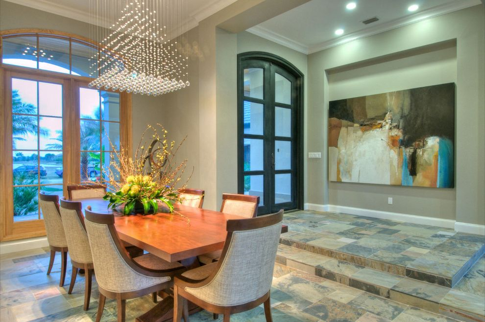 Chandelier Definition   Contemporary Dining Room  and Arched Doors Art Niche Ceiling Lights Crown Molding Dining Chairs Dining Table Glass Doors Modern Chandelier Steps Stone Tile Tile Floors Upholstered Chairs