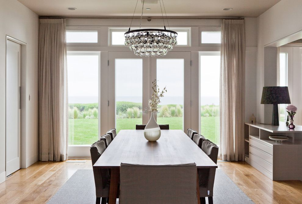 Chandelier Definition   Contemporary Dining Room  and Crystal Chandelier Dining Room Chair Slipcover Glass Doors Glass Wall Hardwood Floors Modern Dining Room Ochre Arctic Pear Chandelier Table Lamp Tan Curtains Teardrop Vase Warm Contemporary