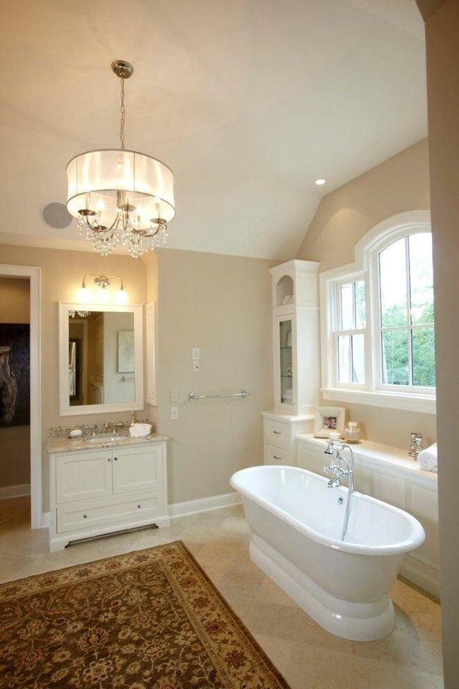 Chandelier Definition with Traditional Bathroom Also Area Rug Baseboards Bathroom Storage Built in Storage Ceiling Lighting Chandelier Freestanding Bathtub Freestanding Vanity Oriental Rug Recessed Lighting Shade Chandelier White Wood Wood Trim