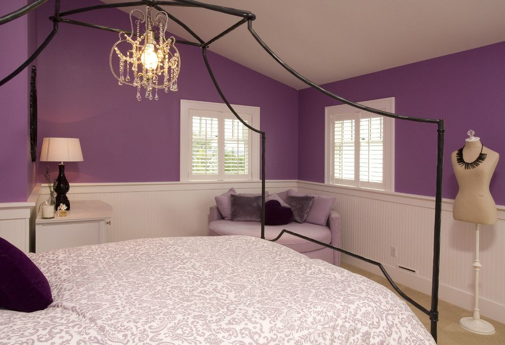 Chandelier for Girl Bedroom   Traditional Kids Also Beadboard Bedside Table Canopy Bed Chandelier Dress Form Nightstand Paisley Bedding Purple Walls Wainscoting White Wood Window Shutters Window Treatments Wood Trim Wrought Iron Bed