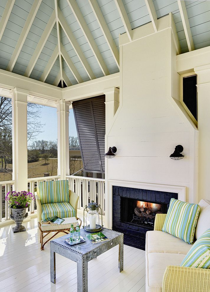 Charleston Homes Omaha with Tropical Porch Also Bahama Shutters Blue Ceiling Deck Exposed Rafters Outdoor Cushions Outdoor Fireplace Painted Wood Patio Furniture Storm Shutters Striped Cushions White Floors Wood Railing