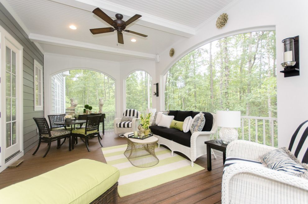 Chavez Roofing   Traditional Porch  and Black Cushions Ceiling Fan Gray Siding Green Cushions Striped Rug White Wicker Furniture