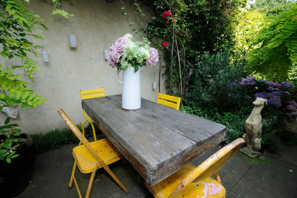 Cheap Patio Table Set   Shabby Chic Style Patio Also Bright Climbing Plants Courtyard Distressed Furniture Floral Arrangement Garden Art Hydrangeas Outdoor Dining Overgrown Pitcher Sculpture Small Space Yellow Accent