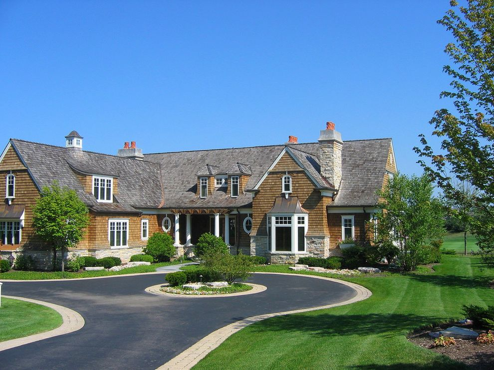 Cheapest Driveway Material with Victorian Exterior Also Bay Window Cedar Shingles Cupola Curved Roof Dormers Driveway Driveway Island Front Door Gables Oval Windows Porch Rafters Shingle Style Stone Chimney Stone Details White Trim