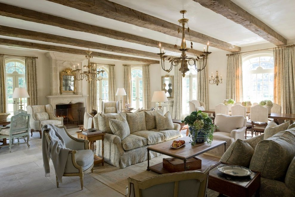 Childress Fabrics with Mediterranean Living Room  and Arched Windows Beige Floor Tile Chandelier Great Room Patterned Sofa Rustic Wood Beams