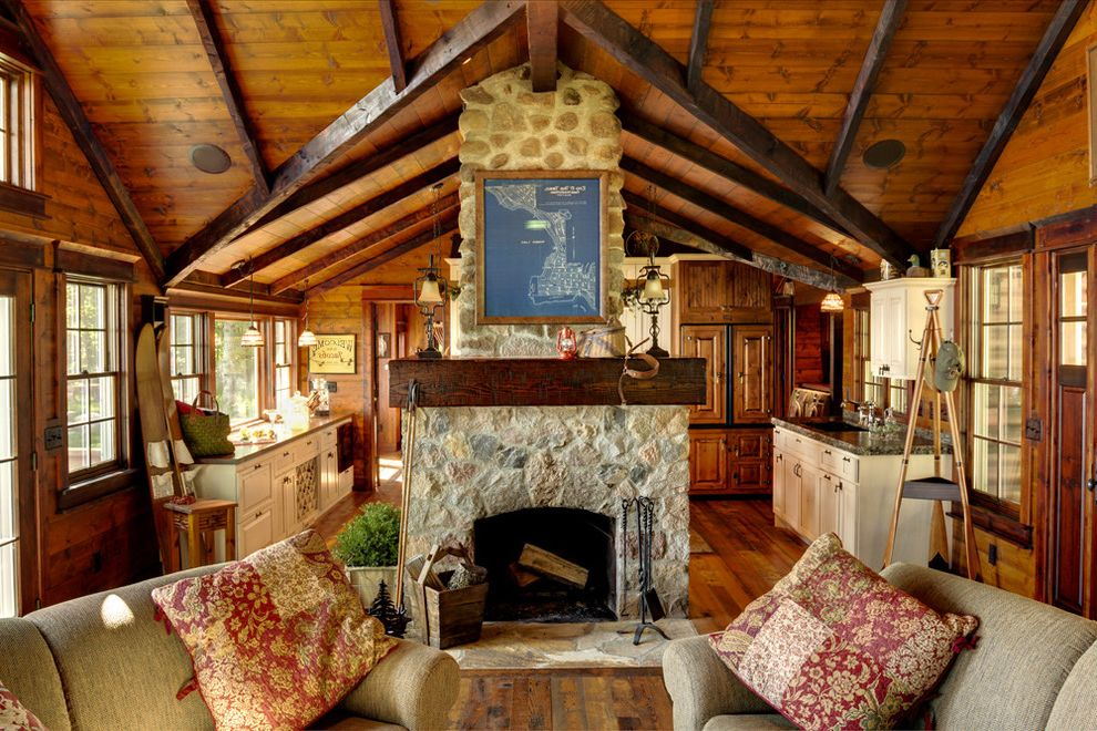 Chimney Sweep Near Me with Rustic Living Room  and Beams Cabin Exposed Beams Family Room Fireplace Fireplace Accessories Rustic Sloped Ceiling Stone Fireplace Surround Vaulted Ceiling Wood Ceilings Wood Flooring Wood Mantel