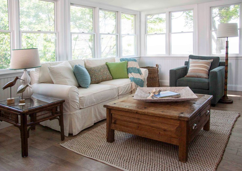 Cindy Crawford Sectional Couch   Beach Style Sunroom Also Bamboo Floor Lamp Beach Style Living Room Beadboard Cane Furniture Coffee Table Double Hung Windows Floor Lamp Jute Rug Light Palette Rustic Side Table Slipcovered Sofa Wainscot Woven Area Rug