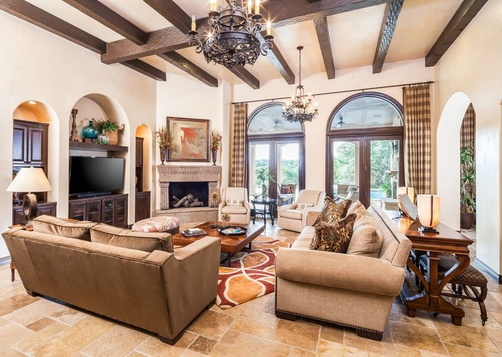 Cindy Crawford Sectional Couch with Mediterranean Living Room  and Arched Alcove Arched Window Beamed Ceiling Brown Floor Tile Chandelier Dark Wood Beams French Doors Glass Doors High Ceiling Transom Window