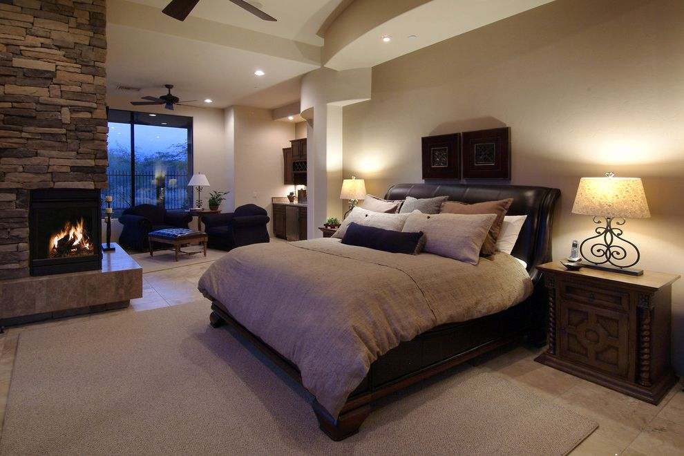 Cindy Crawford Sectional Reviews   Southwestern Bedroom  and Armchairs Ceiling Lights Coffee Table Fireplace Headboard Large Windows Modern Fireplace Nightstand Stone Fireplace Surround Table Lamps Tile Floors