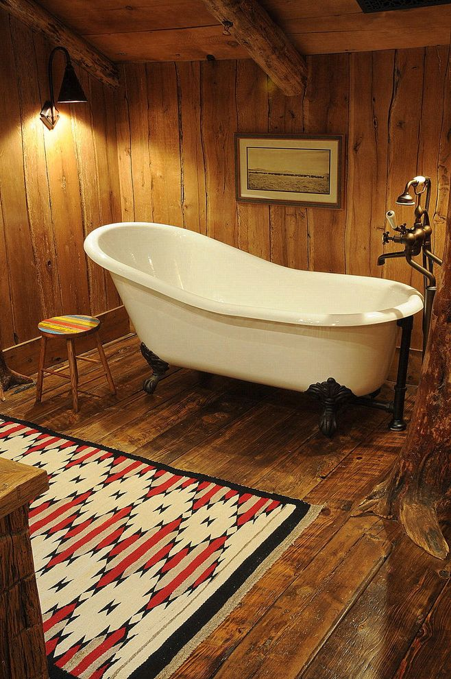 Clawfoot Tub for Sale with Rustic Bathroom Also Area Rug Baseboards Bathroom Claw Foot Tub Exposed Beams Freestanding Tub Rustic Sconce Sloped Ceiling Wall Art Wall Decor Wall Lighting Wood Ceiling Wood Flooring Wood Paneling
