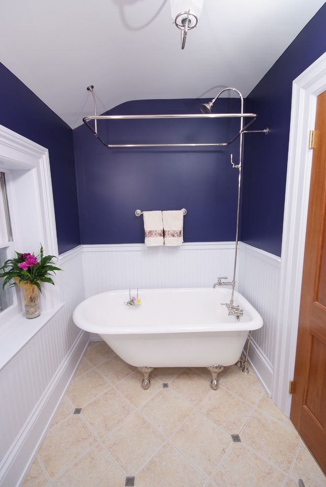 Clawfoot Tub for Sale with Traditional Bathroom  and Beadboard Blue Claw Foot Tub Clawfoot Tub Indigo Small Bathroom Small Bathtub Tile Floor Wainscot White Painted Trim Window Ledge Wood Door