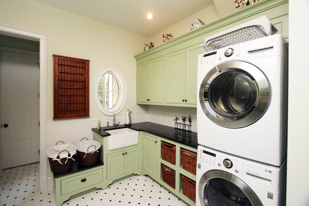 Clothes Dryers at Lowes   Traditional Laundry Room Also Apron Sink Beadboard Farm Sink Farmhouse Sink Green Cabinets Round Window Stackable Washer and Dryer Stacked Washer and Dryer Storage Baskets White Wood Wood Molding
