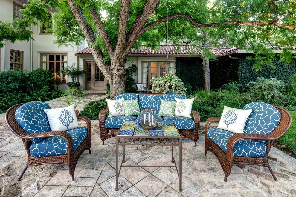 Collis Roofing with Mediterranean Patio  and Blue Cushions Blue Seat Cushions Coral Pillows Mature Tree Outdoor Entertaining Outdoor Fabric Outdoor Furniture Outside Seating Pavers Pool Patio Tile Roof Woven Outdoor Furniture