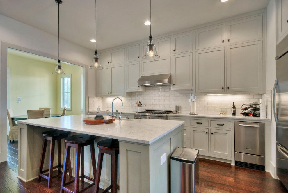Colonial White Granite Countertops with Traditional Kitchen  and Barstool Kitchen Island Pendant Light Range Shaker Kitchen Stainless Steel Subway Tile Tiled Backsplash Wood Floor