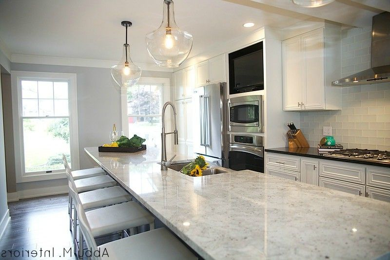 Colonial White Granite Countertops with Transitional Kitchen Also Colonial White Granite Gray Cabinets Gray Wood Floors Kitchen Large Island Modern Kitchen Open Shelving Pendant Lights Styling Open Shelves White Kitchen White Leather Stools
