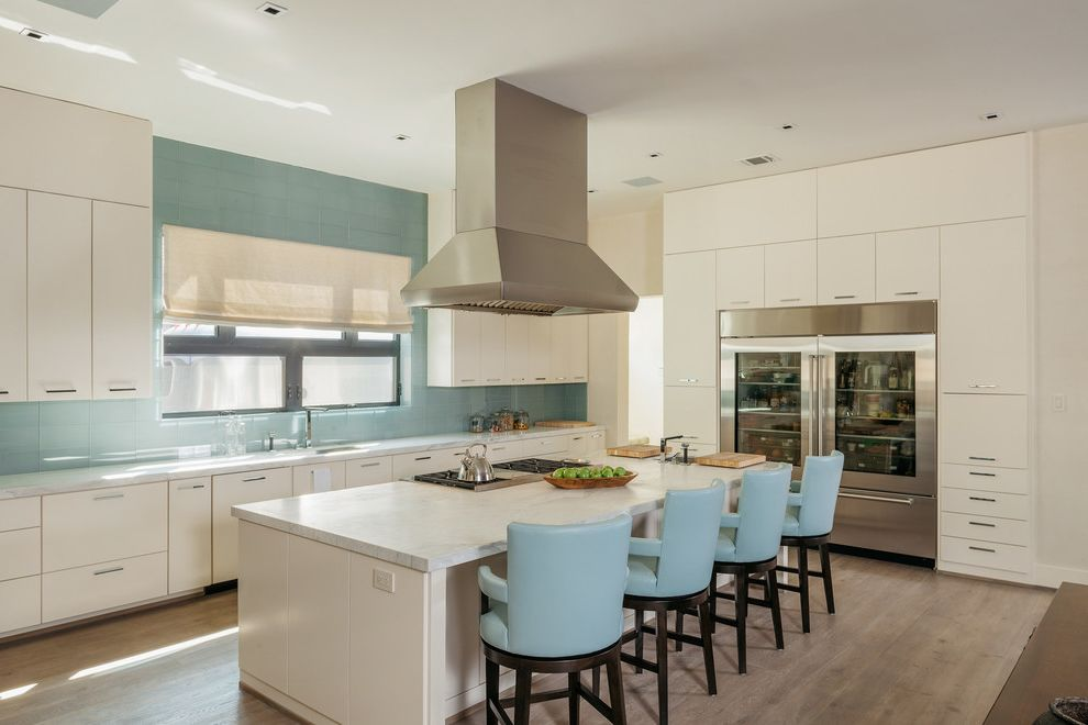 Colored Refrigerators with Contemporary Kitchen  and Clean Lines Counter Stools Glass Front Fridge Light Blue Vent Over Island Window